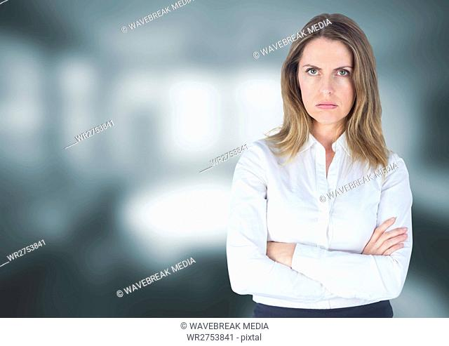 Angry disappointed businesswoman against grey blurred background