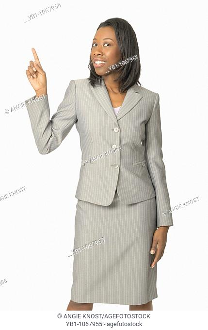 Attractive woman in business suit, pointing up