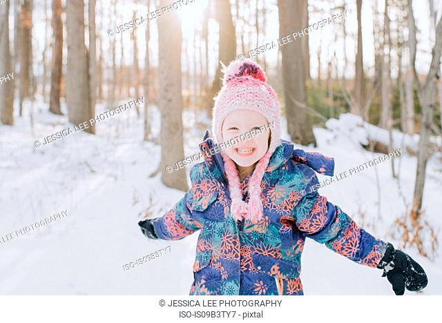 Girl playing in snow, Peterborough, Ontario