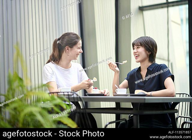 Young girlfriends at a cafe