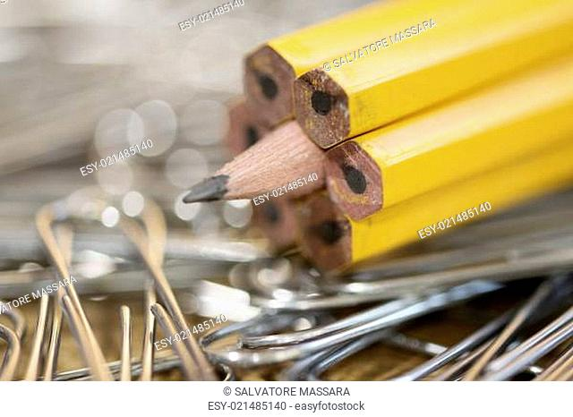 stationery with pencils and metal clips