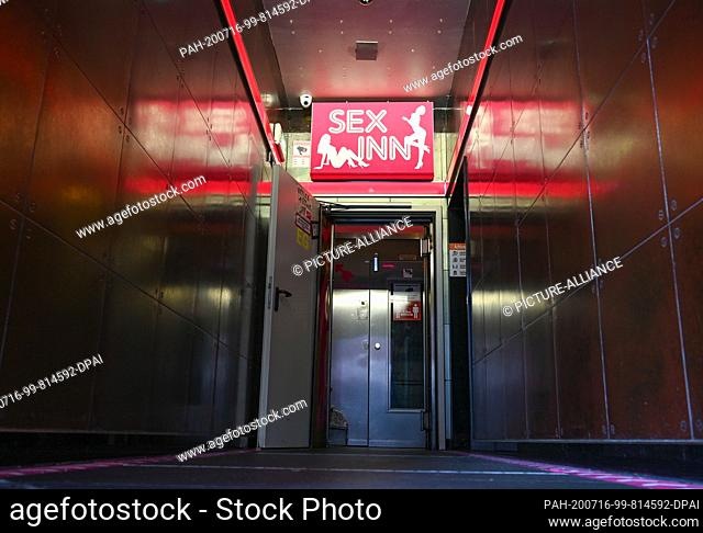 """16 July 2020, Hessen, Frankfurt/Main: View into the entrance area of the running house """"""""Sex Inn"""""""" in the Frankfurt station district"""