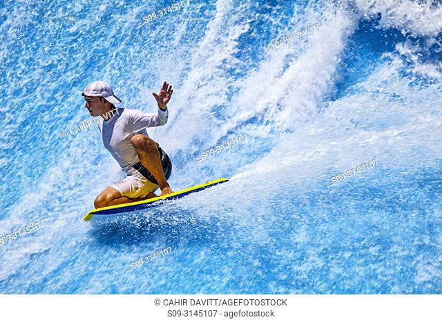 A surfer on the surf wave simulator in the Wild Wadi Water Park, Um Suqaim Second, Dubai, Dubayy, United Arab Emirates