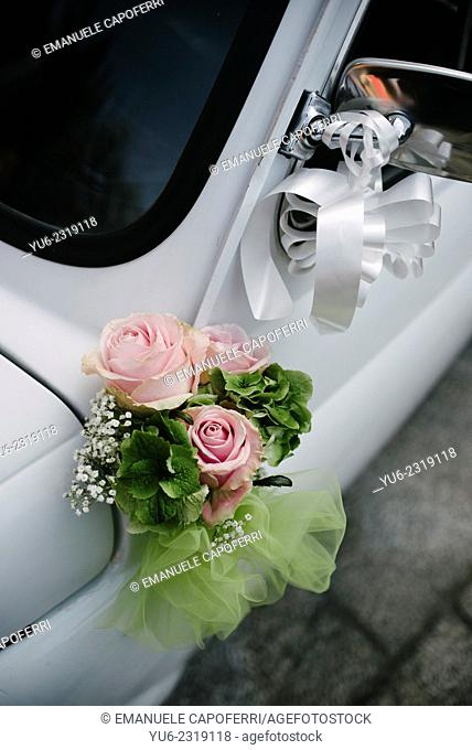 Bouquet of flowers adorn an old fiat 500