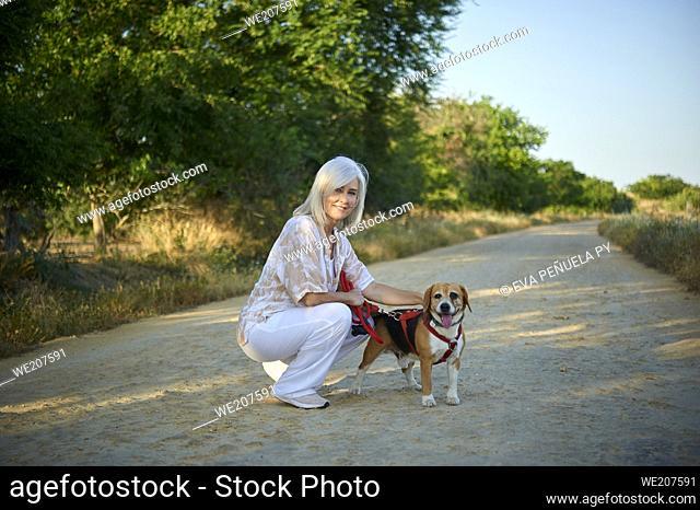 mature woman enjoying a walk in the countryside