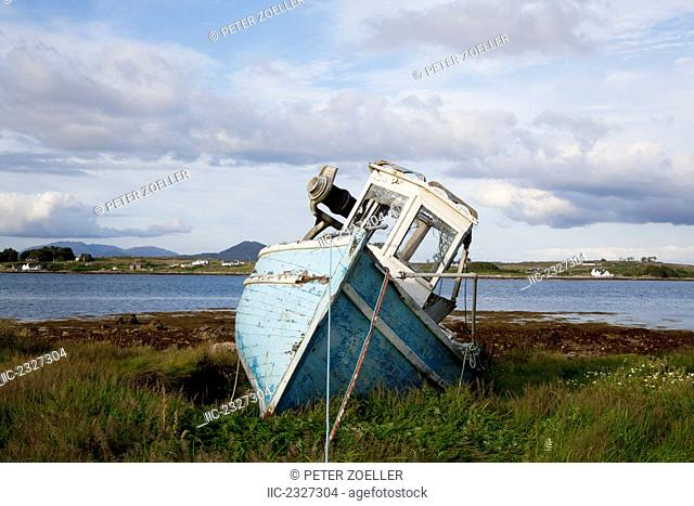 An abandoned fishing boat on the shore near roundstone;County galway ireland