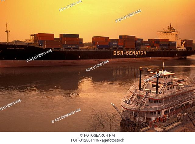 Savannah, GA, Georgia, A huge cargo ship carrying containers passes along the Historic River Front on the Savannah River in Savannah
