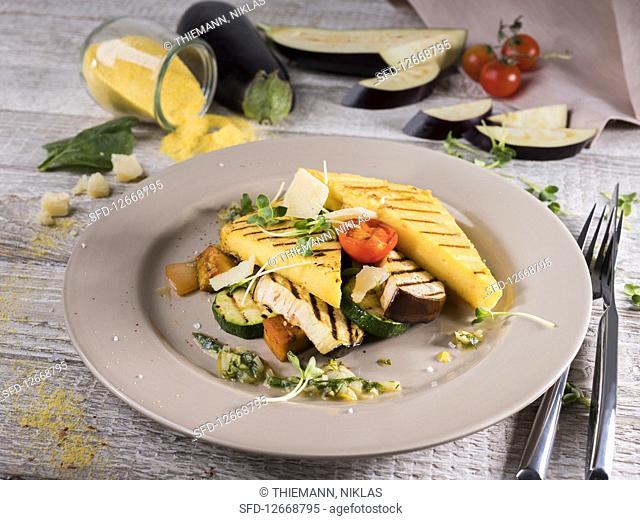 Polenta slices with gremolata, aubergine, zucchini, cress and Parmesan