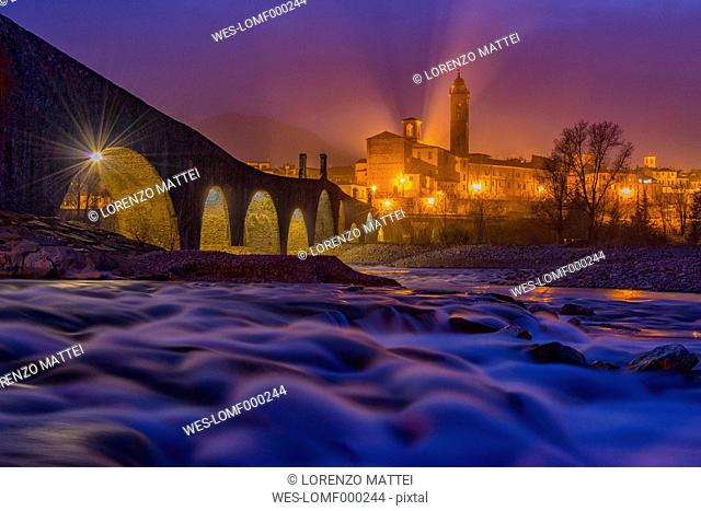 Italy, Province of Piacenza. Bobbio, Ponte Vecchio and the town of Bobbio in the evening