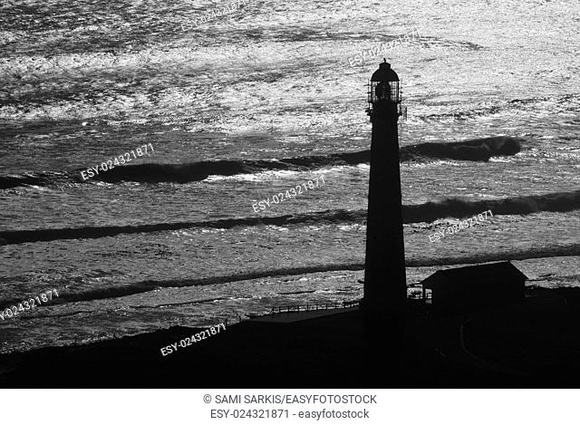 Lighthouse silhouette by ocean, Western Cape Province, South Africa