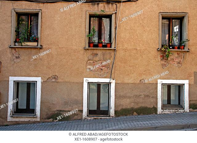 windows, sloping street, Caldes de Montbui, Catalonia, Spain