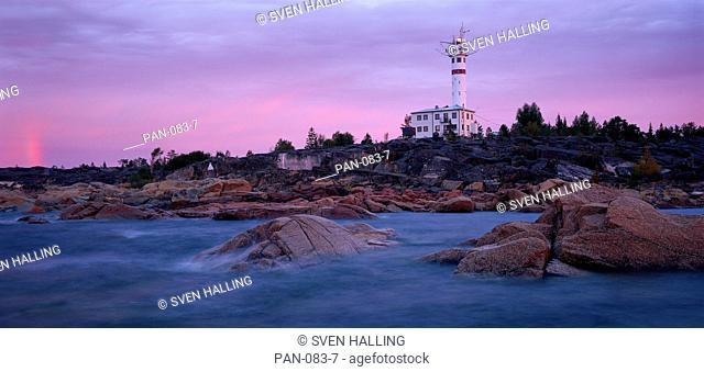 Lighthouse and partial rainbow, Skagsudde, Sweden