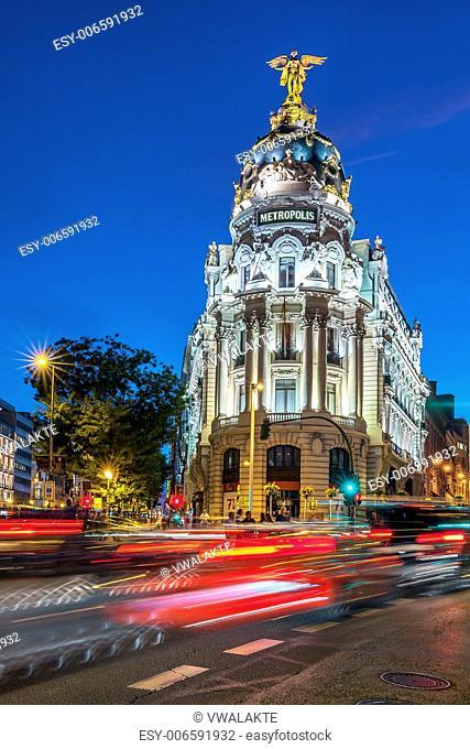 Rays of traffic lights on Gran via street in Madrid at night. Spain, Europe