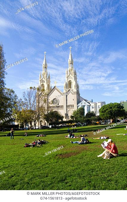 Sunday Afternoon at Washington Square with view of Saints Peter and Paul Catholic Church,San Francisco, California, USA