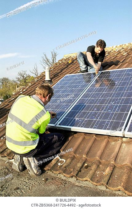 Fitting Photovoltaic panels onto the roof of a house, North london, UK