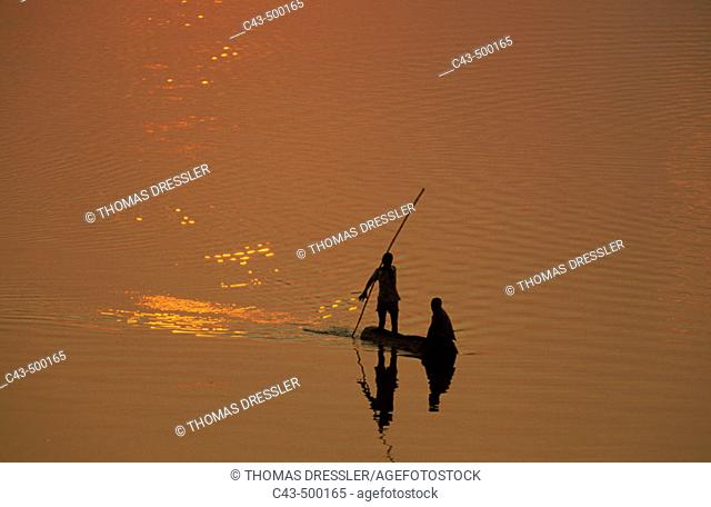 Fishermen at sunset on the Luangwa river. South Luangwa National Park, Zambia
