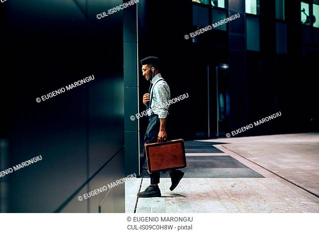Businessman entering office building, Milano, Lombardia, Italy