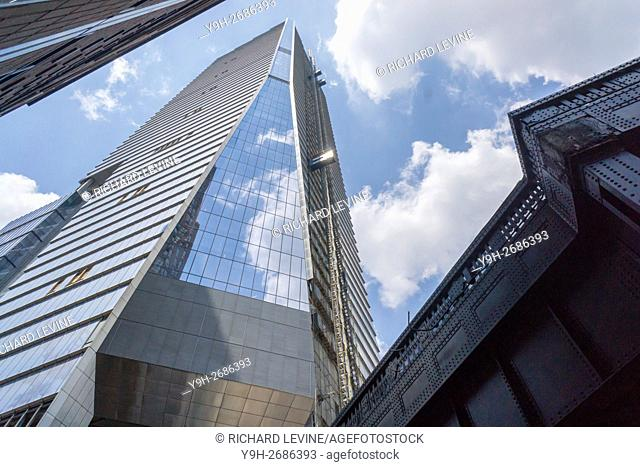 The almost finished 10 Hudson Yards building of the Hudson Yards development opens with the luxury handbag manufacturer Coach moving in 300 employees