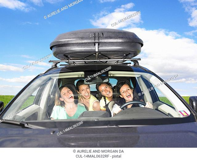 girls singing in car
