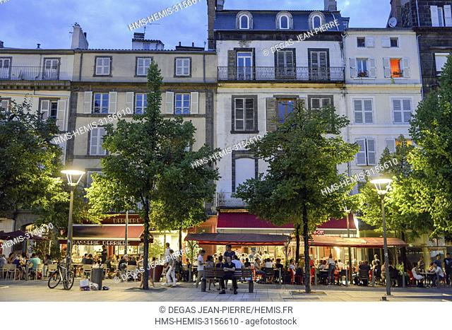 France, Puy de Dome, Clermont Ferrand, Place of Victoire, Café terraces on an esplanade at dusk