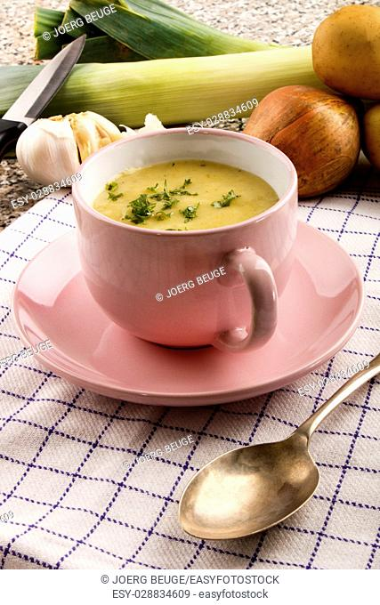 scottish leek and potato soup with parsley in a pink cup