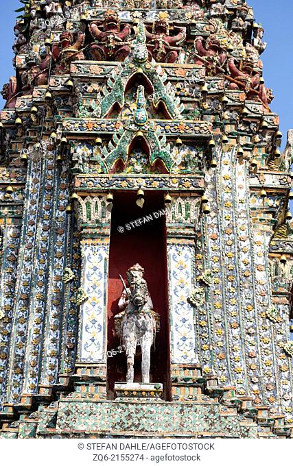 Poecelain Sculptures on the main Prang of the Temple Wat Arun in Bangkok, Thailand