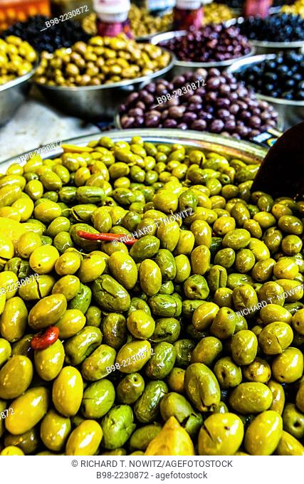 A large selection of different colored olives for sale in Tel Aviv's Carmel Market