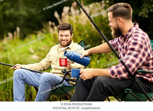 friends fishing and drinking tea from thermos