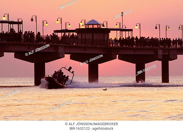 The pier in sunset and a speedboat, Miedzyzdroje, Poland, Europe
