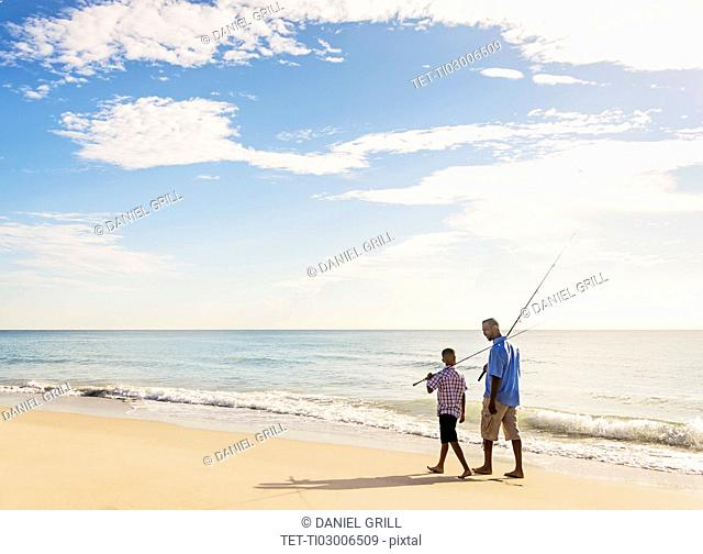 Father and son (10-11) fishing