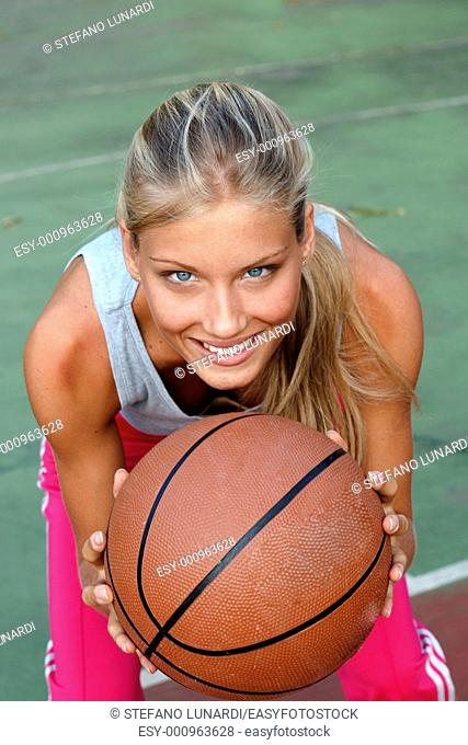 Teenage girl ready to pass the ball