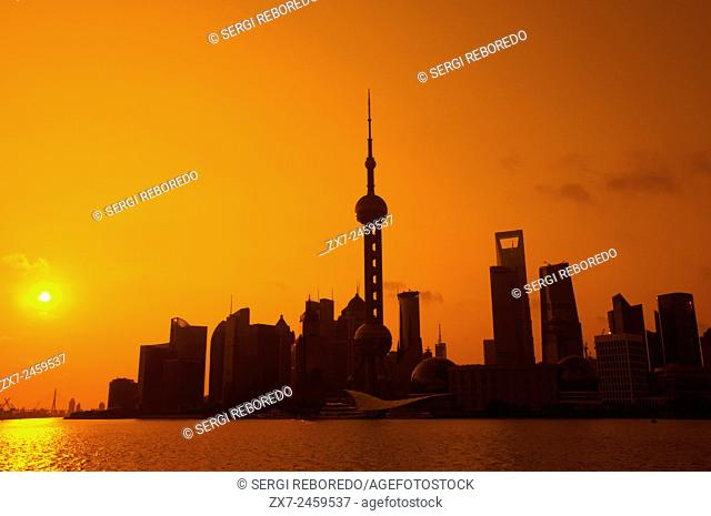 Pudong Skyline, Shanghai, China. Skyline of Pudong as seen from the Bund, with landmark Oriental Pearl tower and Jin Mao tower, Shanghai, China