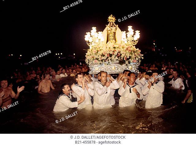 """Procession of """"Virgen del Carmen"""" in the sea at Santa Fe de Los Boliches, on the Costa del Sol. Málaga. Andalucia. Spain"""