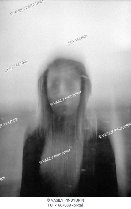Blurred motion of teenage girl against sky