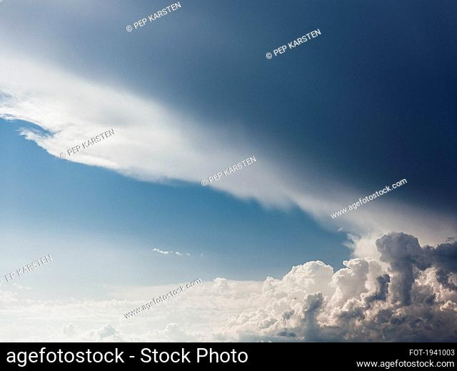 Cloud formations in sunny blue sky