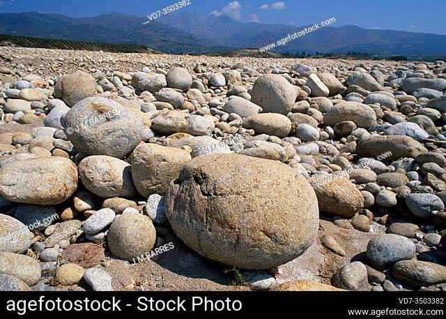 Blockfield and pebble gravel on a torrent. This photo was taken in Caceres province, Extremadura, Spain