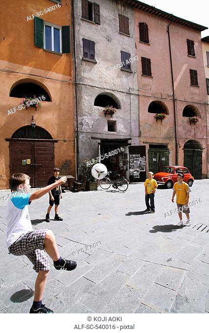 Boys Playing Street Soccer