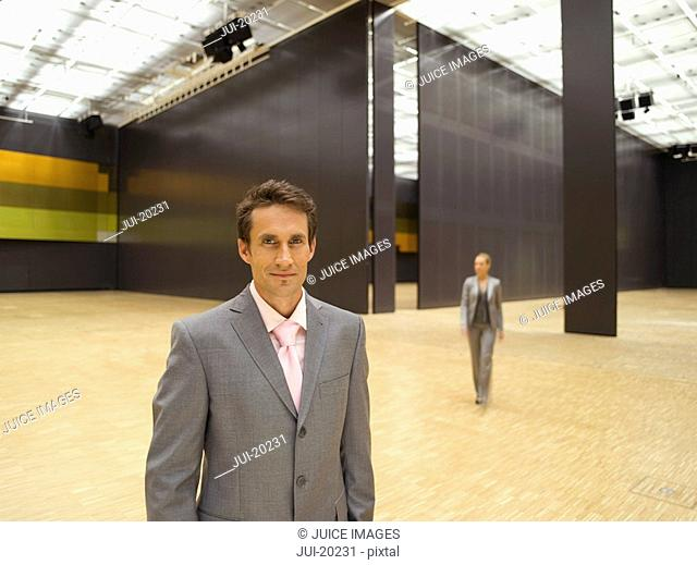 Businessman posing in conference center