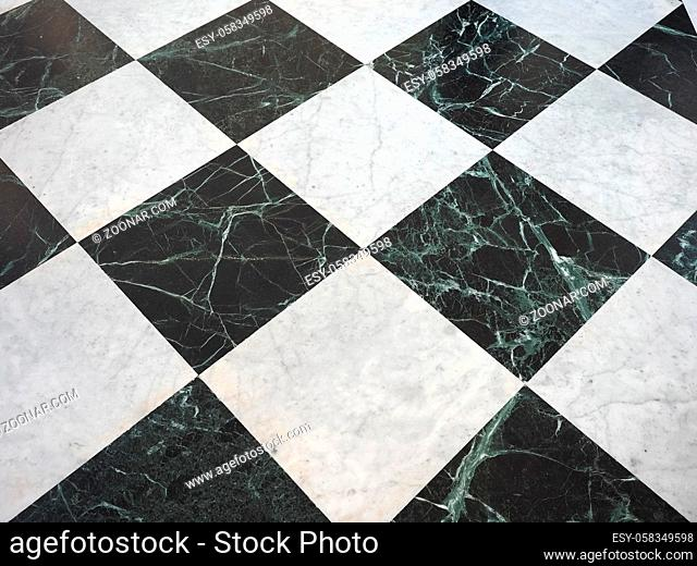 chequered white green and black stone floor useful as a background