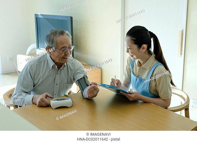 Senior man checking blood pressure