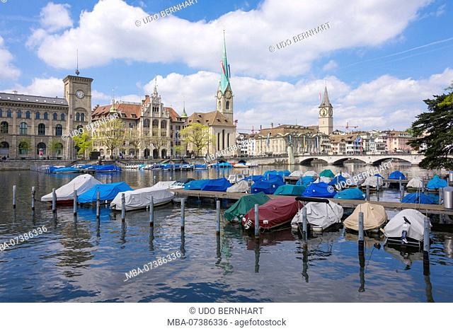 Limmatquai with townhouse and Fraumünster and St. Peter at the cathedral bridge, old town, Zurich, canton Zurich, Switzerland