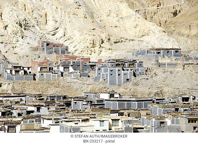 Traditional houses of the old town with grey and dark red painted walls at the mountain slope Sakya Monastery Tibet China