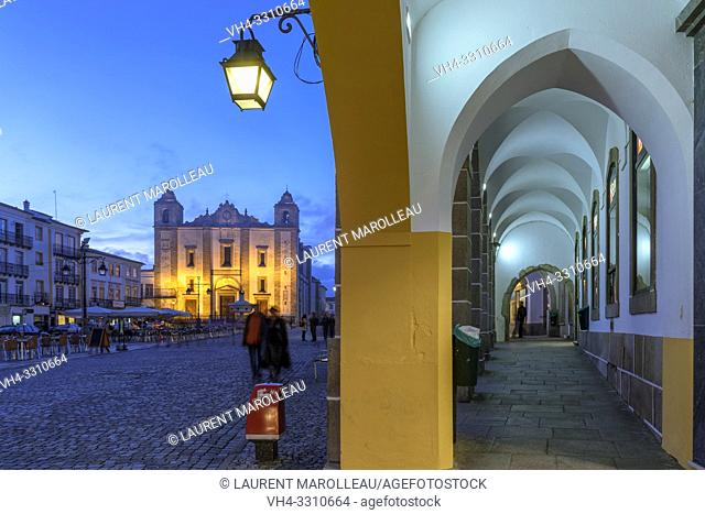 Arcade and Church of Santo Antao at Giraldo Square at Dusk, Evora, Alentejo Region, Portugal, Europe