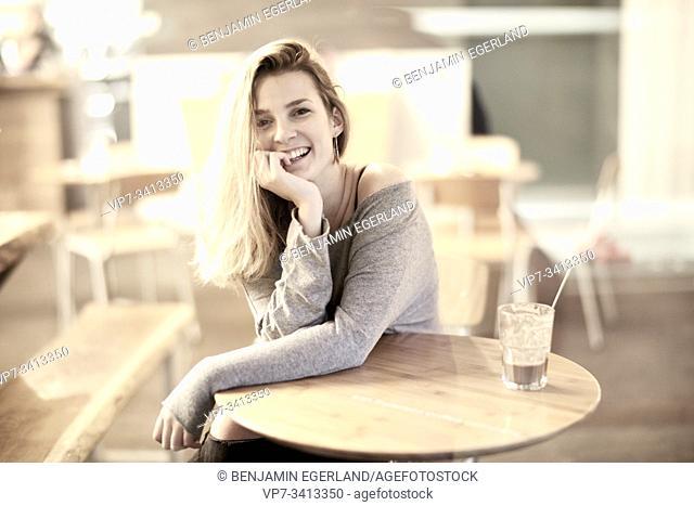 happy woman in café