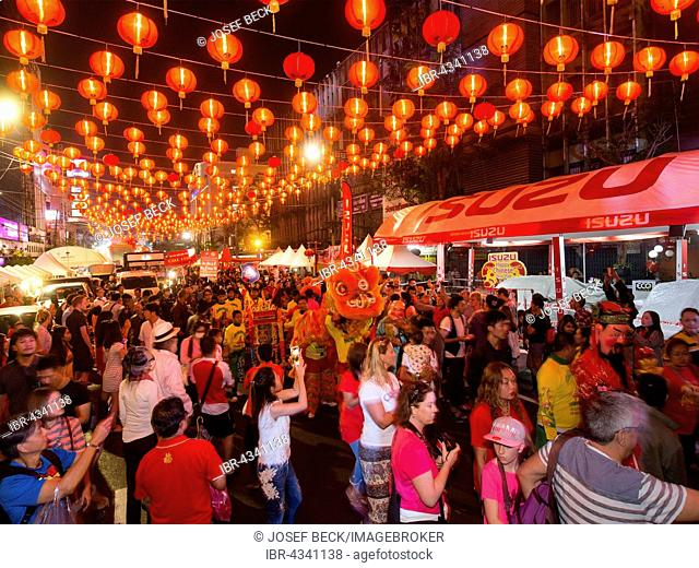 Red chinese lanterns in Yaowarat Road, dragon dance, visitors to the Chinese New Year, Spring festival, Chinatown, District Samphanthawong, Bangkok, Thailand