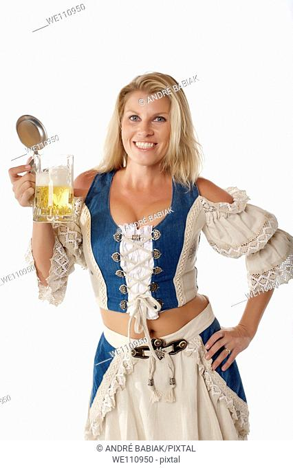 Attractive woman in traditional german dirndl outfit with beer mug