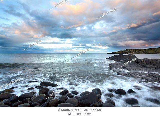 Clouds over the North Sea at Sunset at Greymare Rock Dunstanburgh Northumberland Coast England