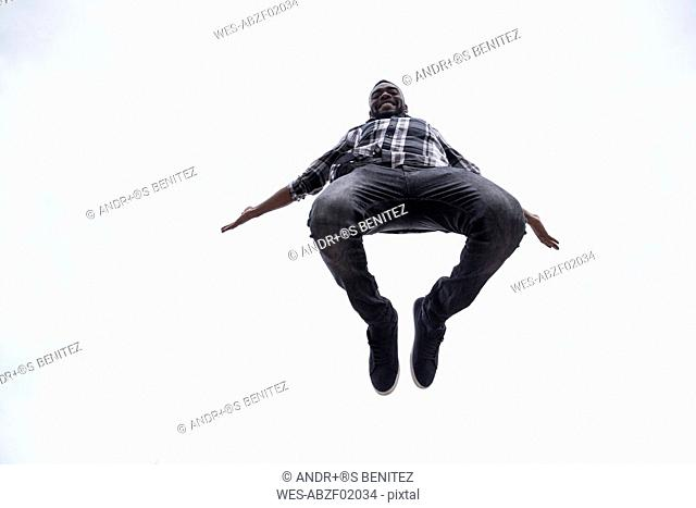 Happy young man jumping in the air