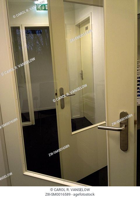 Several doors in a hallway