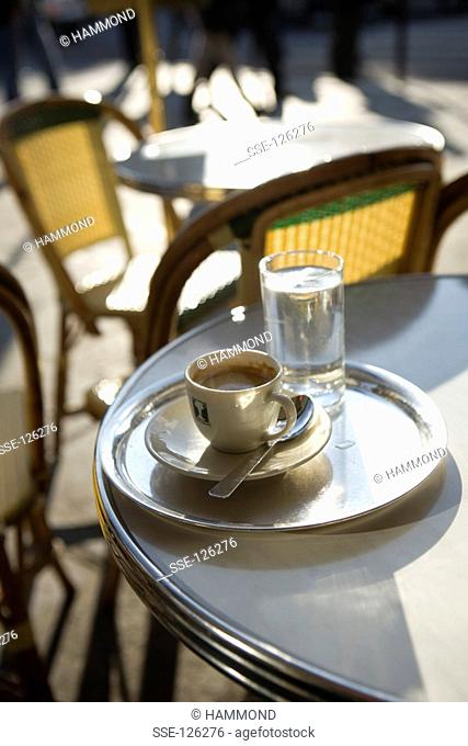 Cup of coffee on a table at the terrace of a Café